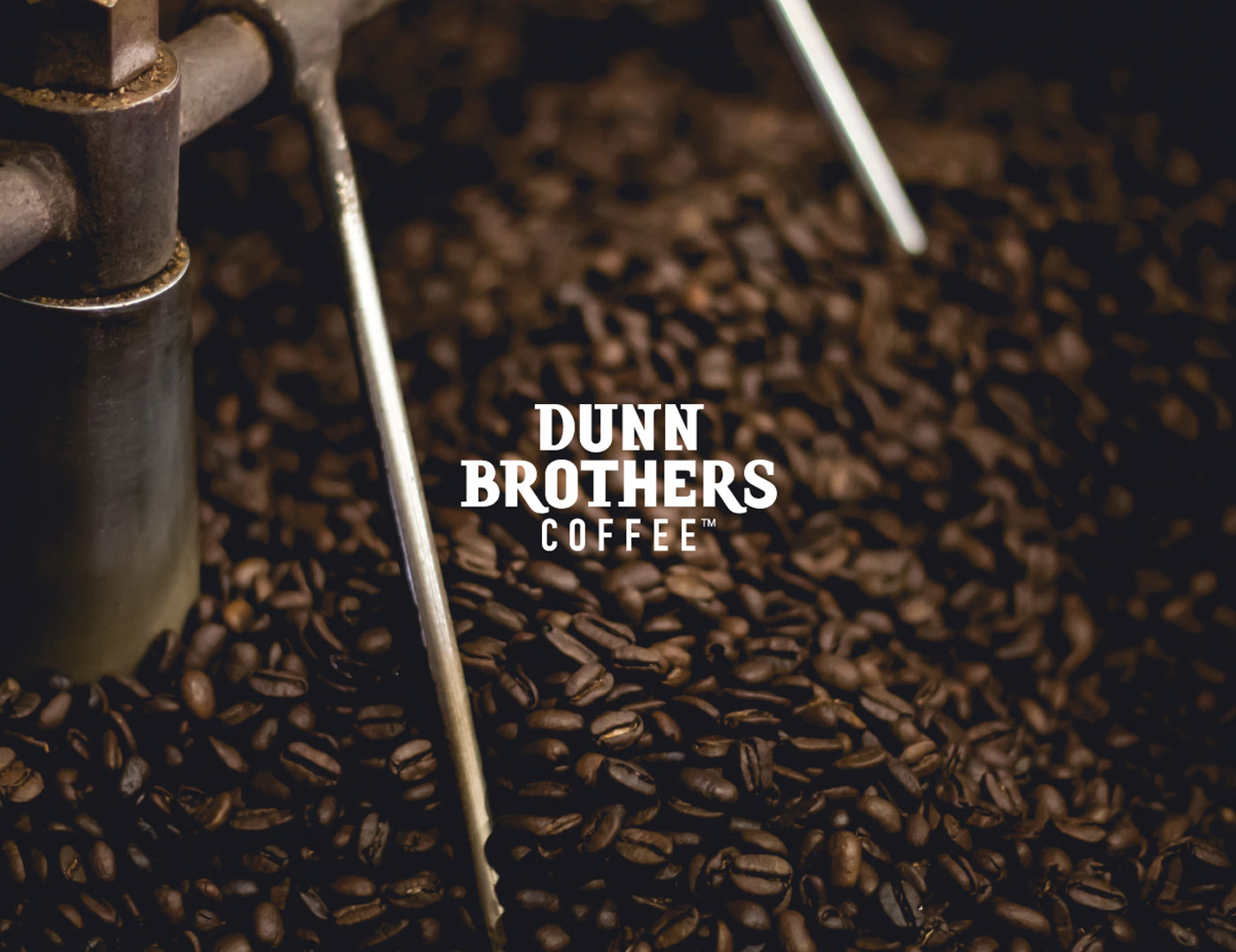 Dunn Brothers logo over roasted coffee beans